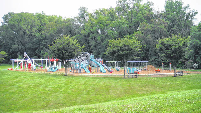 Workers look over the playground on Thursday morning at Sunbury United Methodist Church.