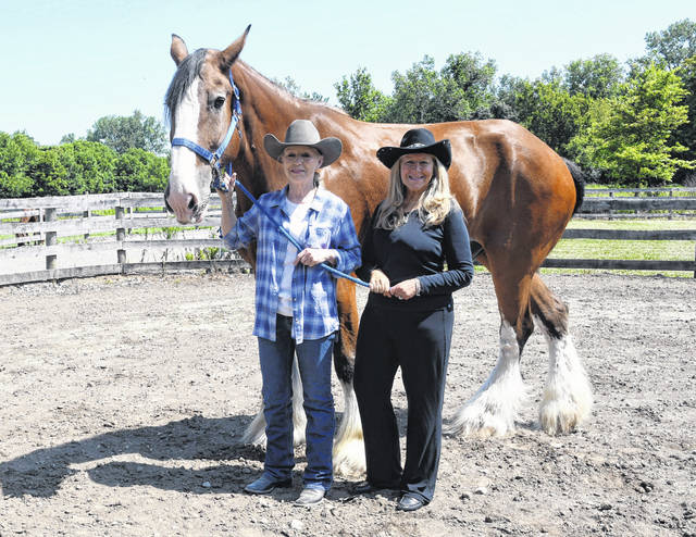 Pictured are Diane Winters at the head of her horse and Jeri Jenkins of Columbus and Delmar Distributing.