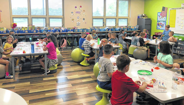 Students take part in a class lesson at Buckeye Valley West Elementary School during the first week of school. On Wednesday, the Buckeye Valley Board of Education voted 3-2 to approve a mask mandate for students kindergarten through eighth grade.