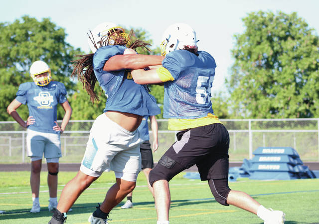 Olentangy players prepare for the 2021 season earlier this month in Lewis Center.