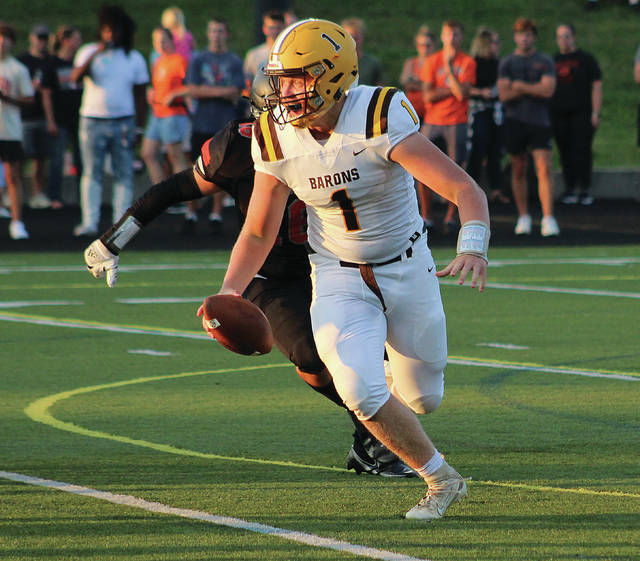 Buckeye Valley's Gabe Gregg (1) scrambles during the first half of Friday's season opener against host Delaware Hayes.