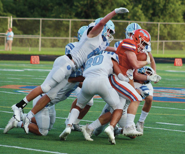 A handful of Olentangy Berlin defenders drag down Olentangy Orange's Drew Dunham during the first half of Friday's non-league showdown in Lewis Center.