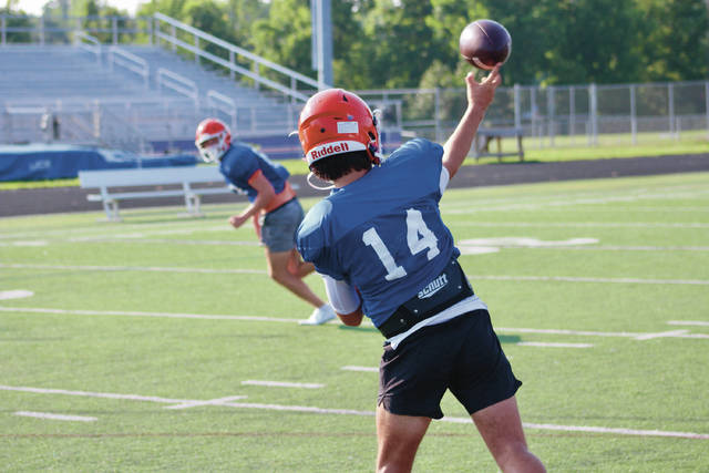 Olentangy Orange players prepare for the upcoming season earlier this month in Lewis Center.