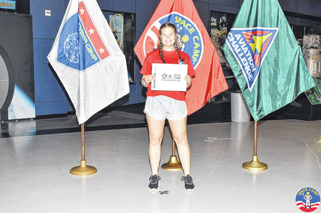 Local student Rachel White stands with her diploma after graduating from Space Camp last month. White joined students from around the country in a weeklong program that trained students in various space missions and gave them hands-on experience.