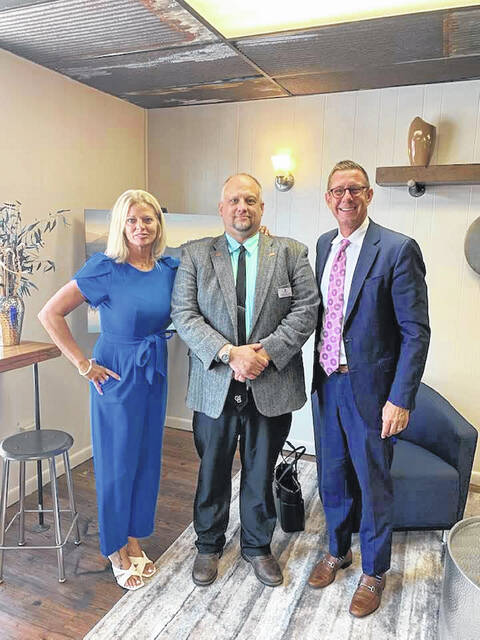 Pictured in the new Coldwell Banker Realty office in downtown Delaware are Branch Manager Julie Guy-Schrienk, Toby Boyce and Coldwell Banker Realty President Joe King.