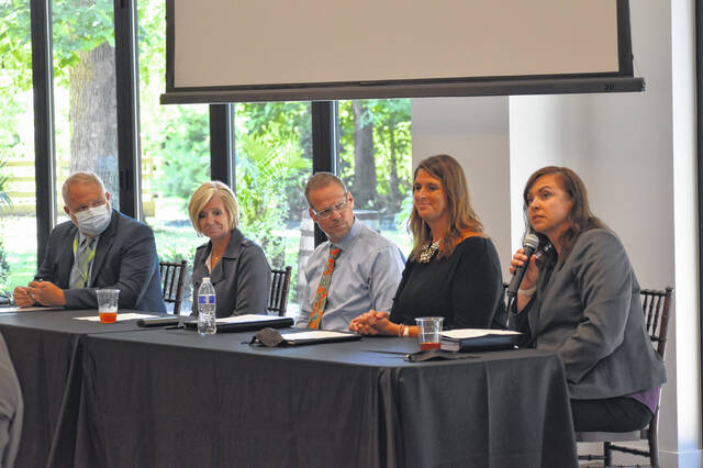 """Local school leaders speak to members of the Delaware Area Chamber of Commerce Thursday morning during the annual """"State of the Schools"""" discussion. Pictured, left to right are DACC Superintendent Jay Poroda, Olentangy Director of Communications Krista Davis, BV Superintendent Andy Miller, Delaware Superintendent Heidi Kegley and BW Superintendent Angie Hamberg."""