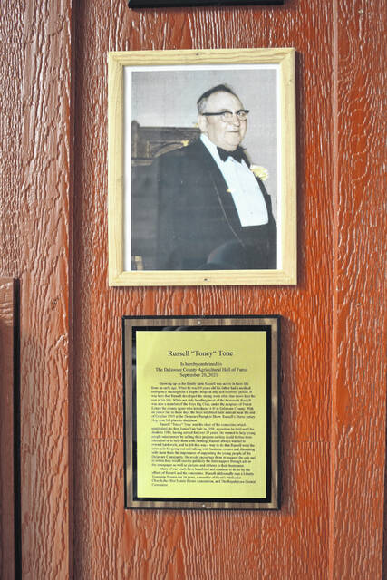 """A plaque with information about Russell """"Toney"""" Tone, the latest inductee into the Agricultural Hall of Fame, hangs in the Ag Center at the Delaware County Fairgrounds."""