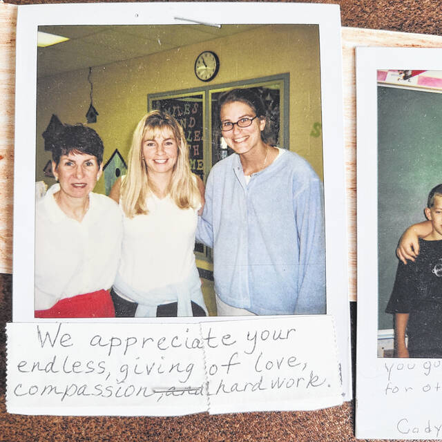 A photo from 2001 shows then-Conger Elementary School teachers Gloria Varner, Becca Oberfield, and Lisa Rehark posing for a picture. The photo was one of many attached to the banner and poster sent to New Jersey from fourth grade students at Conger in 2001.