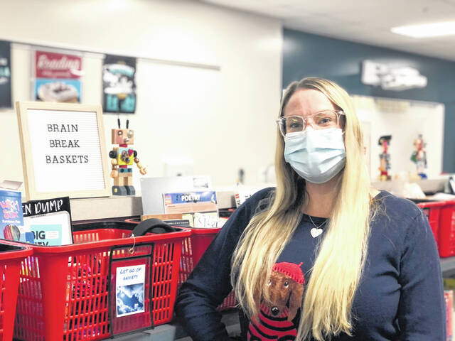 Media Center Specialist Grace Hammond stands next to a Brain Break Basket in the Media Center at the Delaware Area Career Center.