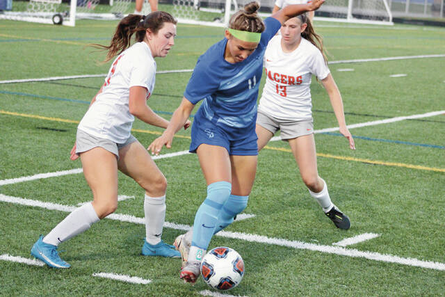 Olentangy Berlin's Cameryn Susey (11) weaves through Delaware Hayes defenders Hayli Marsch, left, and Sammy West during the first half of Thursday's non-league showdown.