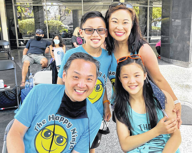 America Ninja Warrior Junior contestants Dylan and Sydney Yee, of Powell, are pictured alongside their parents, Christina and Ken Yee.