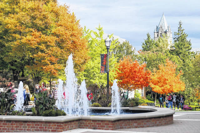 Ohio Wesleyan University students walk across campus on a fall day back in October 2018.