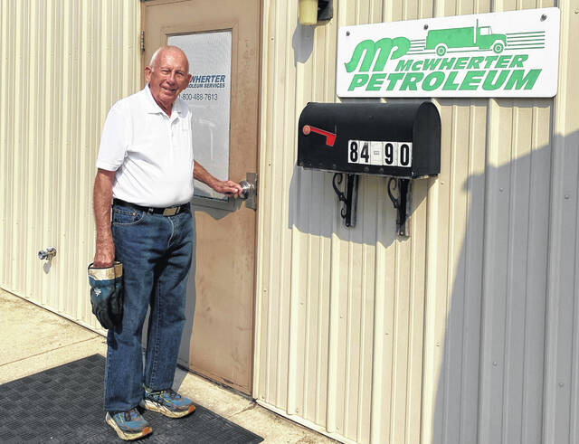 Earl McWherter stands outside the office door to McWherter Petroleum Services, a business he founded 50 years ago on Ross Street in Delaware.