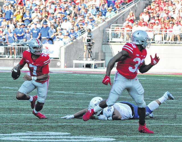 OSU quarterback C.J. Stroud scrambles out of the pocket during the first half of Saturday's home game against Tulsa.