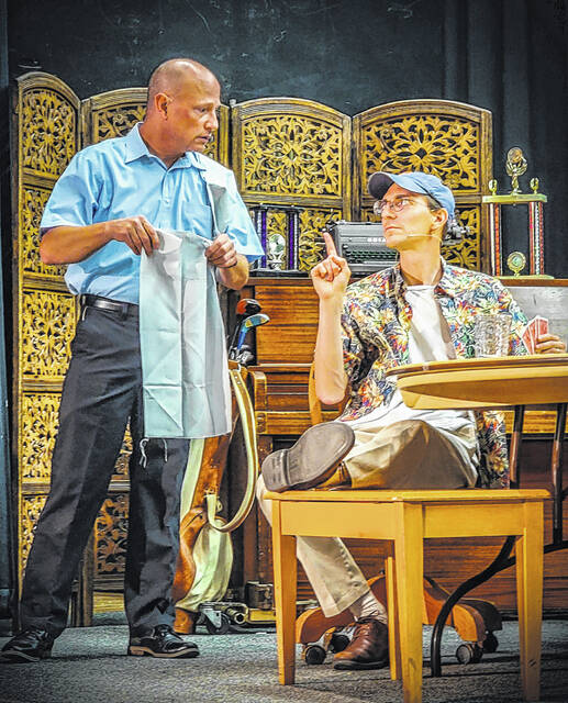 """Bud Kalbaugh, left, and David Hejmanowski, right, rehearse on stage at the Willis Drama Center on Tuesday for the upcoming Arena Fair Theatre's production of """"The Odd Couple."""""""