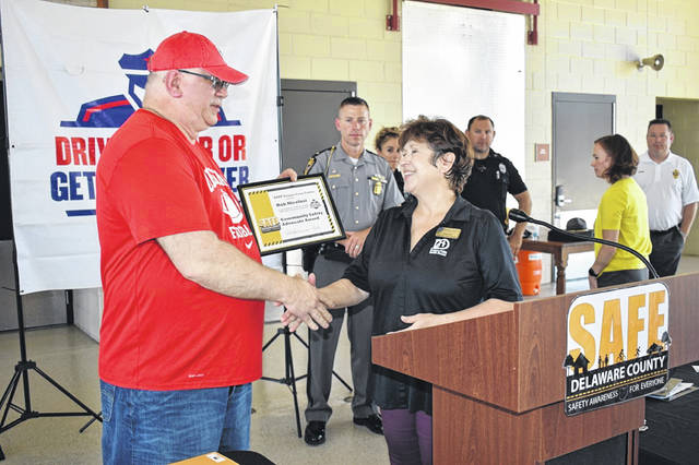SAFE Delaware County Coordinator Jackie Bain, right, presents a certificate to Rob Nicolosi, an recovered impaired driver, Friday during an event promoting safety ahead of Labor Day weekend.