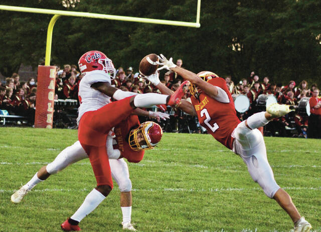 Big Walnut's Dom Salazar and Nicky Pentello (2) defend Westerville South receiver Javi'er Wills during the first half of Friday's OCC-Capital Division clash in Sunbury. Pentello nearly came down with an interception on the play.