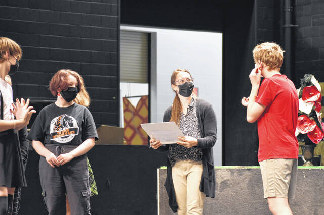 Director Kelsey Wright (center) gives directions to cast members during rehearsals Wednesday.