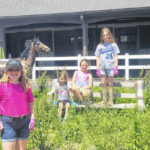 Girl Scouts spruce up fairgrounds