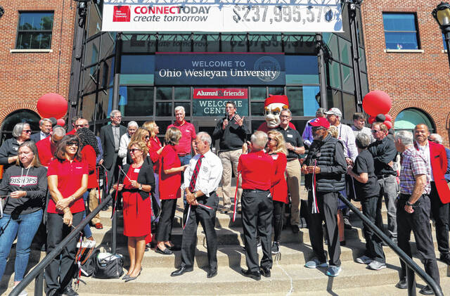 Ohio Wesleyan President Rock Jones (center) announces the total of the university's seven-year Connect Today, Create Tomorrow fundraising campaign Friday. The record-setting campaign raised nearly $238 million in gifts and pledges.