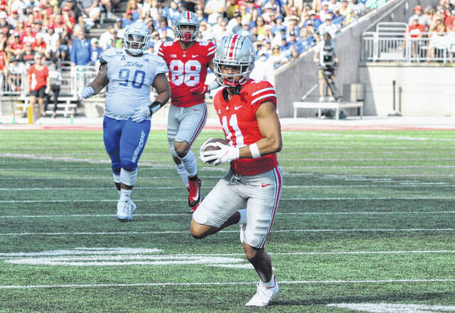 Ohio State sophomore wide receiver Jaxon Smith-Njigba runs free in the open field after hauling in a catch during the Sept. 18 home game against Tulsa.