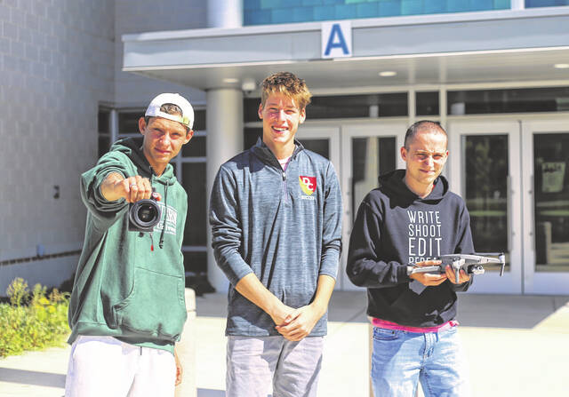 Delaware Area Career Center Digital Design students who assisted the Delaware County Sheriff's Office with a traffic experiment stand outside the school with the aerial drone they used for the experiment. Pictured, left to right, are Kai Mays, a senior from Delaware Hayes High School; John Fashian, a home-schooled senior; and Colson Abshire, a senior from Big Walnut High School.