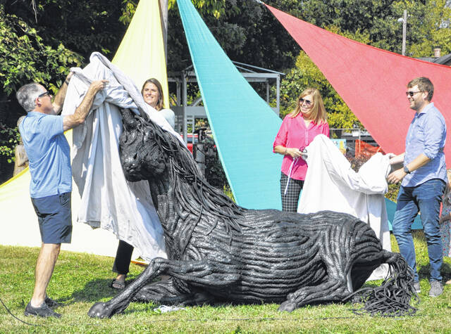 """Several local leaders were on hand Saturday at Boardman Arts Park in Delaware for the unveiling of the """"Unicorn"""" sculpture. Pictured, left to right, are Delaware County Commissioner Jeff Benton, Delaware City Schools Superintendent Heidi Kegley, Delaware Mayor Carolyn Riggle and Delaware City Councilmember Drew Farrell."""