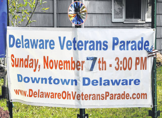 A sign outside the residence at 96 Elizabeth St. in Delaware reminds passerbyers of the upcoming Delaware Veterans Parade.
