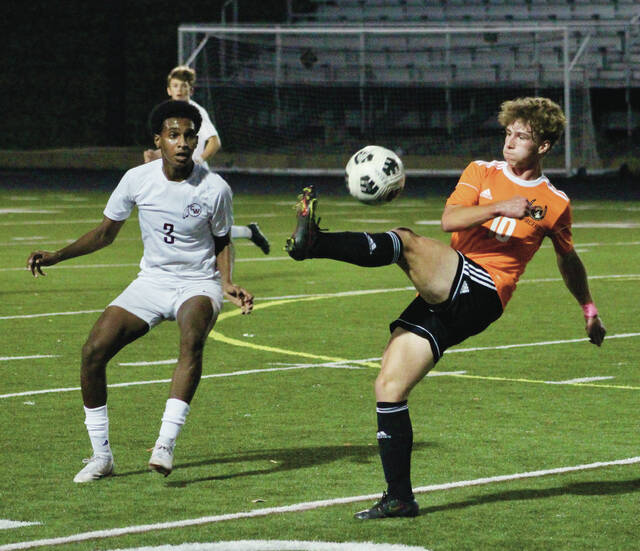 Delaware Hayes' Brayden Shorter (10) controls the ball in front of Canal Winchester's Hussam Mohamednour (3) during the first half of Tuesday's OCC showdown in Delaware.