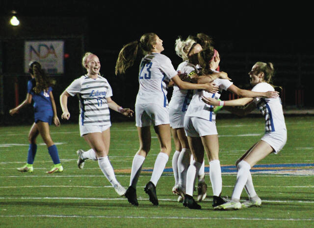 Members of the Olentangy Liberty girls soccer team celebrate after earning a draw Tuesday night against host Olentangy Orange. The result was good enough to earn the Patriots the league title.