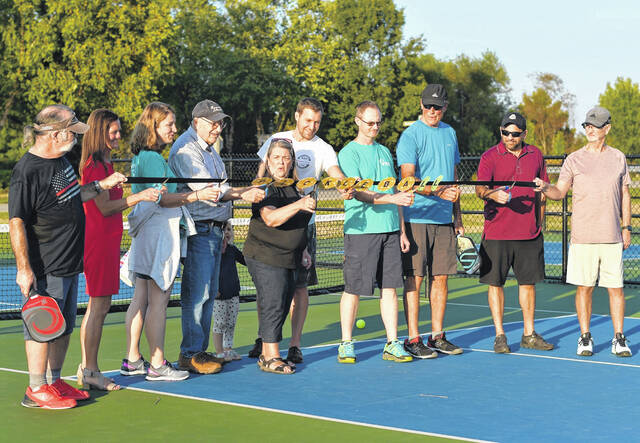 Genoa Township's Park Advisory Committee and community leaders join in the ribbon-cutting celebration of a new pickleball court at Center Green Park.
