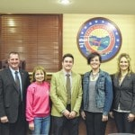 Commissioners present four charities with checks from commissioners ball