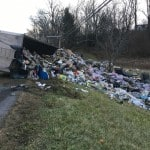 Garbage truck closes road, makes mess