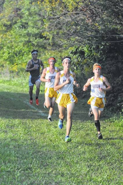 Eaton's Tanner Titkemeyer (front left), Alex McCarty (right) and Cole Bulach lead the Eagles Cross Country team to a county title on Tuesday, Sept. 19.