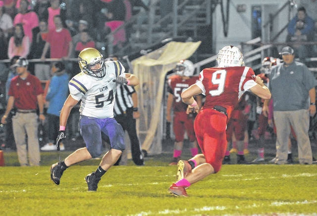 Eaton's Breven Perry closes in on Carlisle quarterback Jake Moore. Eaton fell to 3-6 with a 28-20 loss to the Indians on Thursday, Oct. 19.