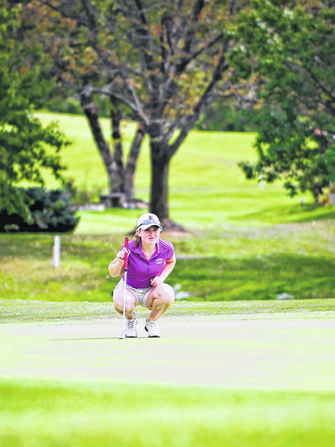 Eaton's Sarah Willis lines up a putt during the Division II district tournament last week. Willis tied a district record with a 3-under par 69 to win the event.