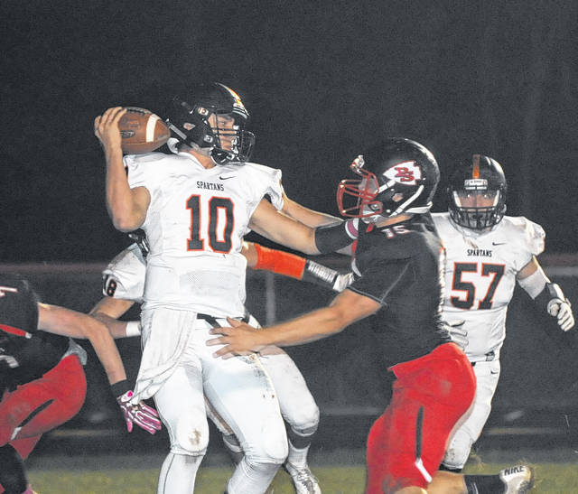 Eddie Mowen Jr. | The Register-Herald Preble Shawnee's defense puts pressure on the Waynesville quarterback to force a fumble and recovered for a touchdown. The Arrows beat the Spartans 26-17 to improve to 6-2 on the season.