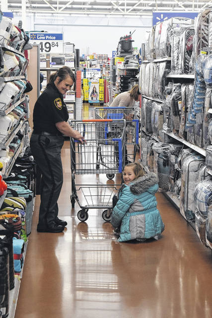 The annual Cops and Kids event, organized by the Fraternal Order of Police, Floyd E. Spitler Lodge 158, was held on Wednesday, Dec. 13. Cops from all different Preble County organizations took over Walmart to make several children's holidays bright.