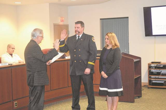 Brian Smith was appointed the official Eaton fire chief in 2017. The ceremony included his swearing-in by Mayor Dave Kirsch and ended with Smith's wife pinning on his badge.