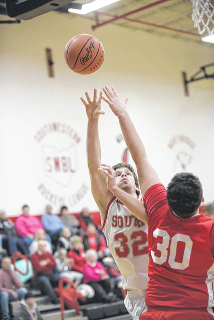 Twin Valley South's Travis Lovely puts up a shot during the consolation game of the Preble Shawnee Holiday Tournament on Saturday, Dec. 30. Lovely scored a game-high 29 points to lead the Panthers to a 66-63 win over Springfield Northwestern.