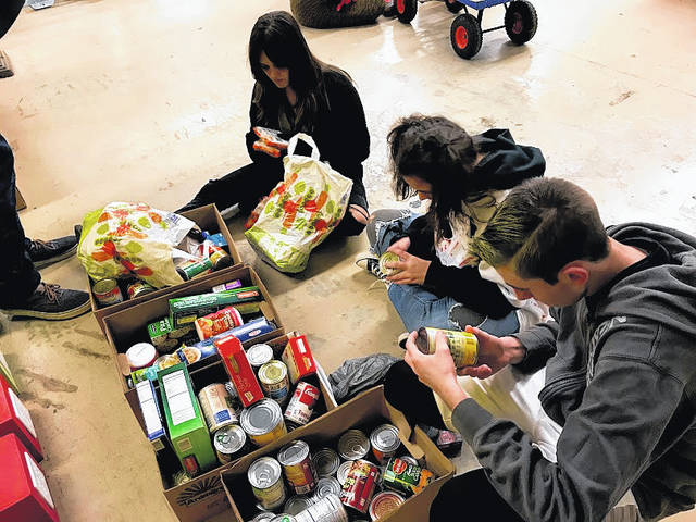 On Oct. 31, the Twin Valley South FFA chapter held their October FFA meeting, members carved/painted pumpkins, ate terrific food, had a costume contest, and went Trick -or- Treating for canned goods.