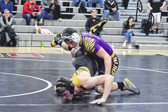 Eaton senior Spencer Reynolds battles Mason Simindinger of Sidney during a dual meet on Saturday, Feb. 3 at Covington. Reynolds won the match with a pin in 1:42.