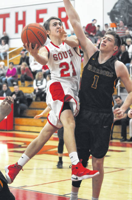 Twin Valley South's Jacob Wells drives to the basket during the Panthers game with Dayton Christian on Saturday, Feb. 17. South got off to a slow start, falling behind 12-0, before eventually losing, 78-52.