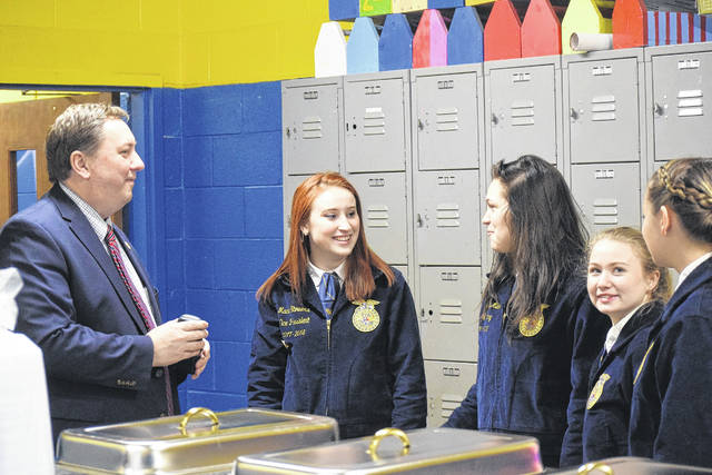 National Trail's Miami Valley Career Technical Center (MVCTC) FFA Chapter held its annual Legislative Luncheon on Friday, March 23. The luncheon brought FFA students together with community representatives and state legislators to eat and converse, bringing the students a valuable opportunity that most people don't get to experience. Pictured, State Representative Jeff Rezabeck speaks with FFA members.