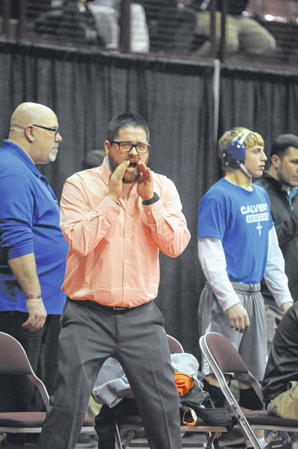 National Trail wrestling coach Bobby Clark yells out instruction to Peyton Lane during Lane's consolation match at the OHSAA state tournament on Thursday, March 8. Lane went 1-2 during the state tournament to conclude his season with a 33-4 record and a top 12 finish at 132 pounds in Division III.