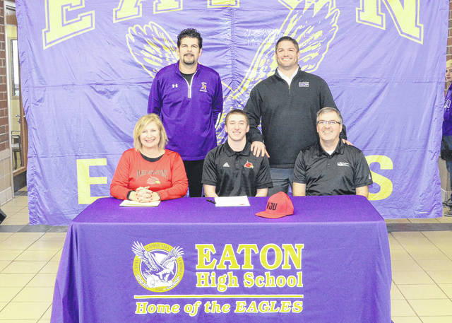 Eaton senior Chip Parker (front middle) recently signed his letter of intent to play college football at Wheeling Jesuit University in Wheeling, West Virginia. He is pictured with his parents Debbie and Jeff Parker, along with Eaton Athletic Director Travis Miller and Eaton football coach Brad Davis (back row).