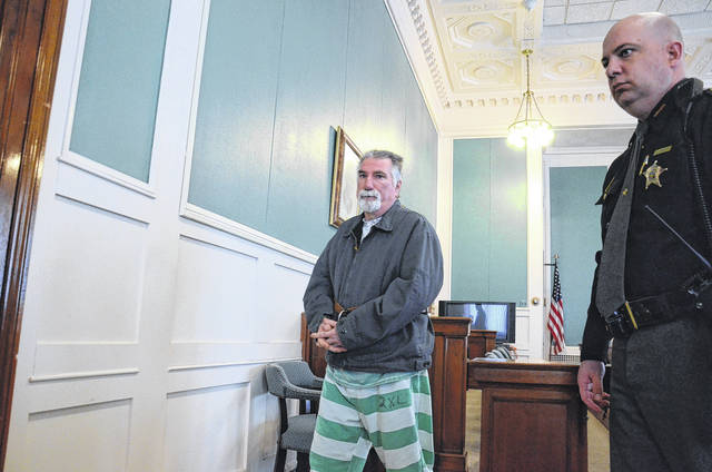 Gabriel Schaaf exits the courtroom after his sentencing on Tuesday, March 13. Preble County Common Pleas Court Judge David Abruzzo sentenced Schaaf to life in prison with the possibility of parole after 25 years for the 2016 murder of his son Jonathan.