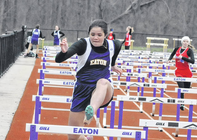 Eaton's Tyler Pittman clears a hurdle during the Eagle Relays on Tuesday, April 10.