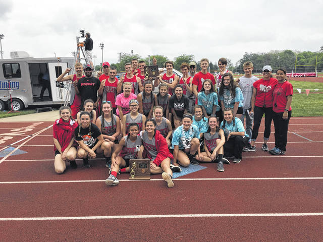 Twin Valley South's boys and girls track team pose with their respective district championship trophies on Saturday, May 19.