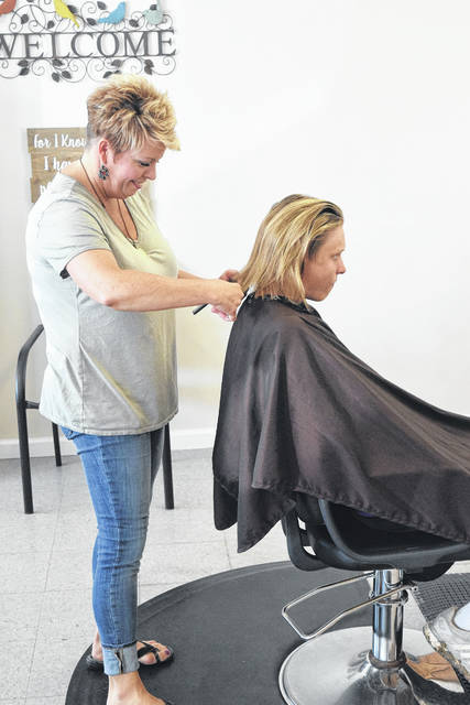 Off the Top Salon and Tanning opened Tuesday, May 22 at 4269 Ohio 732 West in Eaton. While she admitted this location has been a salon a few different times, owner Lisa Chandler is committed to keeping the space for herself. She will not close and is dedicated to serving the community, she said.